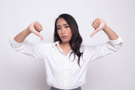 Unhappy Asian girl show thumbs down with both hands on white background