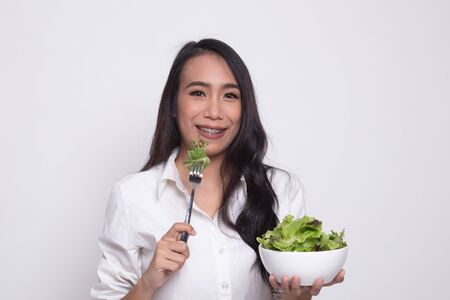 Healthy Asian woman with salad on white background