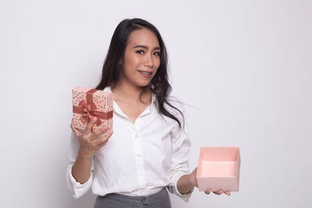 Young Asian woman open a golden gift box on white background