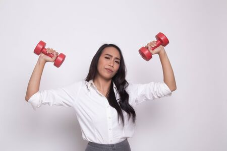 Exhausted Asian woman with dumbbells on white background Reklamní fotografie