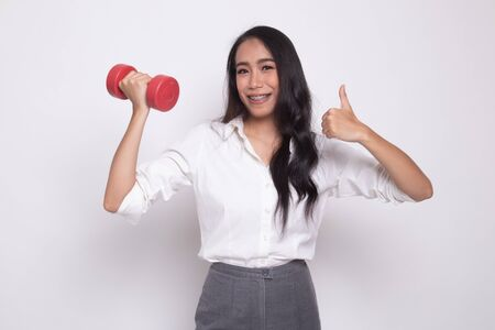 Healthy Asian woman thumbs up with dumbbells on white background