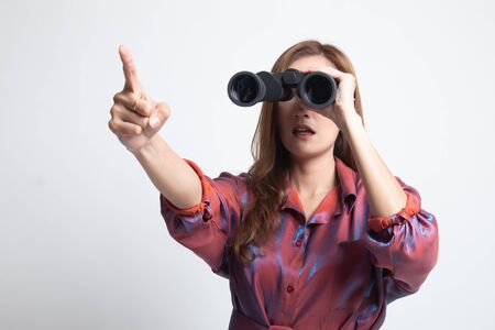 Young Asian woman  point and look with binoculars on white background
