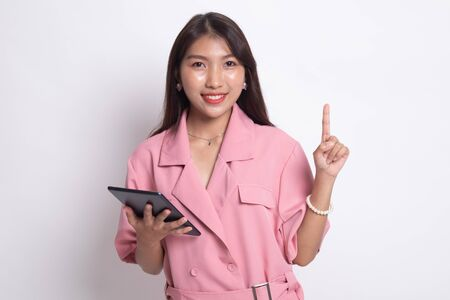 Young Asian woman with a computer tablet on white background. Banco de Imagens