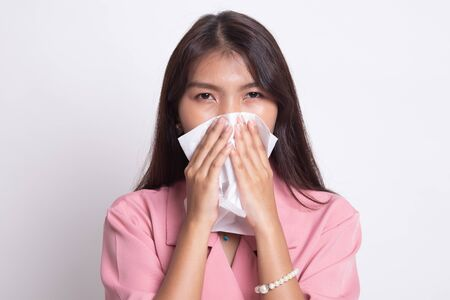 Young Asian woman got sick and flu on white background.