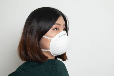 Young Asian woman wearing N95 mask to prevent PM2.5 dust air pollution Stock Photo