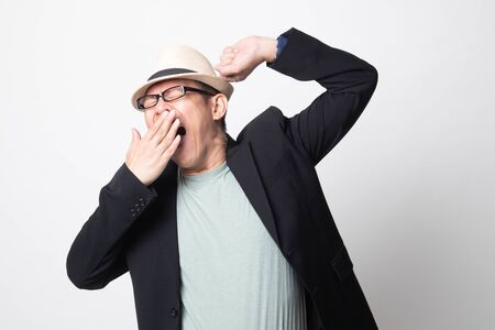 Sleepy adult asian man  yawn on white background 写真素材
