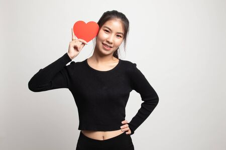 Asian woman with red heart on white background 版權商用圖片