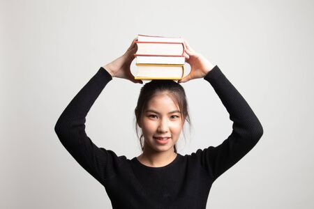 Young Asian woman studying  with may books on white background