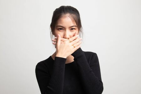Beautiful young Asian woman close her mouth on white background 版權商用圖片