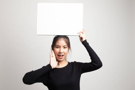 Young Asian woman surprise with white blank sign on white background