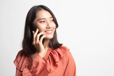 Young Asian woman talking with mobile phone on white background