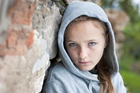 Little sad child with hoody. Stock Photo - 16275316