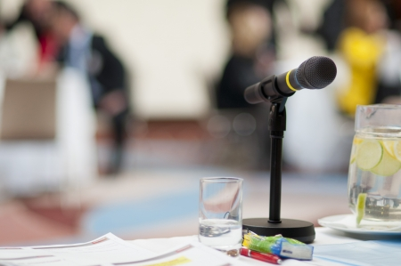 conference speaker: Indoor business conference for managers.
