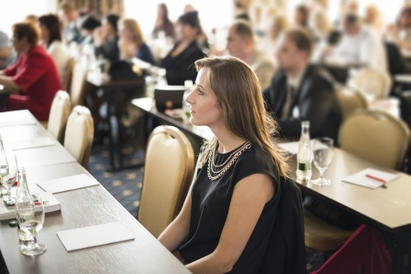 audiences: Indoor business conference for managers.