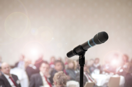 public speaker: Indoor business conference for managers.