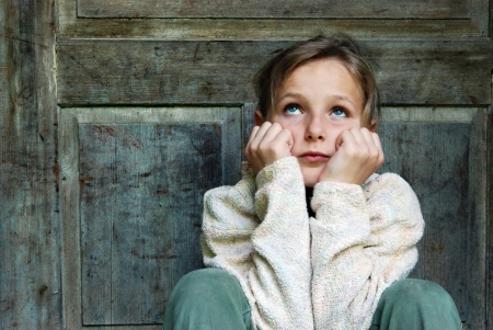 Sad little girl feels lonely Stock Photo - 16615319
