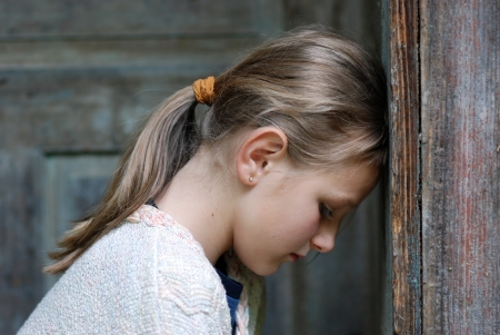 lonely girl: Sad little girl feels lonely