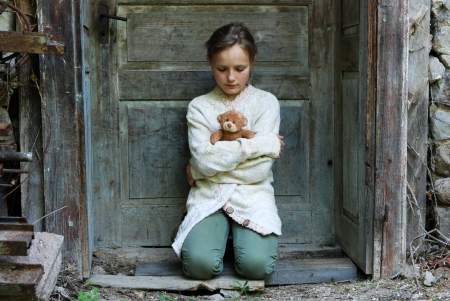 lonely child: Sad little girl feels lonely