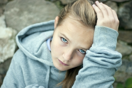 young teen girl: Little sad child is lonesome