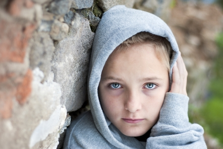 orphan: Little sad child is lonesome. Stock Photo