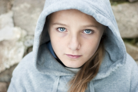 depressed teenager: Little sad child is lonesome. Stock Photo