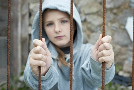 slave girl: Little sad child is lonesome. Stock Photo