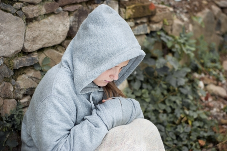 child abuse: Little sad child is lonesome. Stock Photo