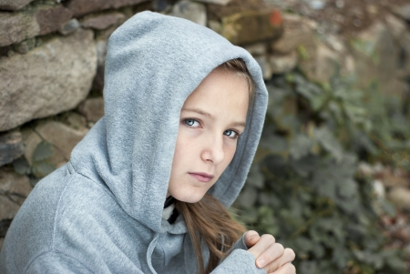 domestic: Little sad child is lonesome. Stock Photo