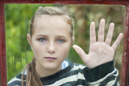 homeless children: Sad young girl feels lonely. Stock Photo
