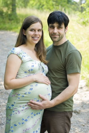 human fertility: Husband with pregnant wife is resting in nature.