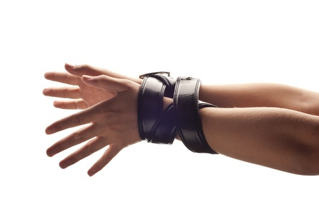 Hands of woman are tied up by belt. Stock fotó