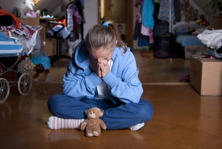 angry teddy: Sad teenager is in depression  Stock Photo