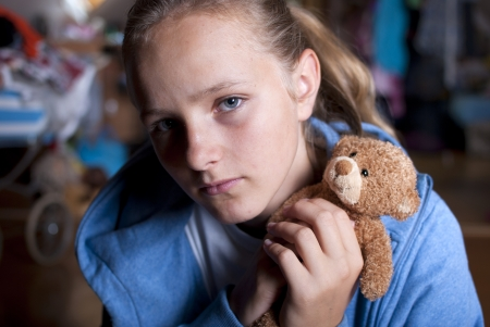 angry teddy: Sad teenager is scared and abused.