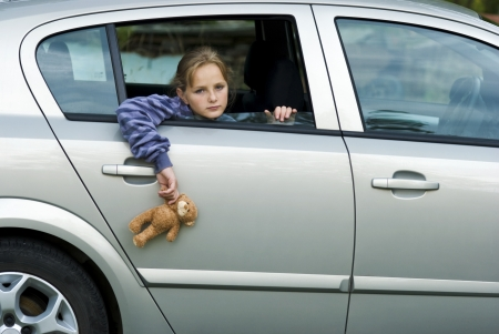 sad eyes: Little girl in car is going to miss her friends