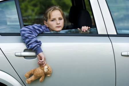 Little girl in car is going to miss her friends  Stock Photo - 16615432