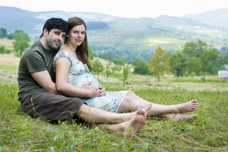 Husband with pregnant wife is resting in nature. Stock Photo - 16334605