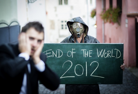 Business man is scared of the end of the world Stock Photo - 16334603