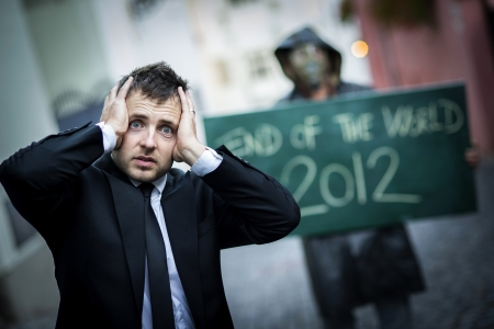 Business man is scared of the end of the world Stock Photo - 16334573