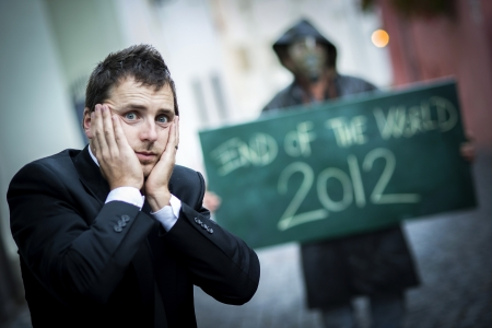Business man is scared of the end of the world Stock Photo - 16334568
