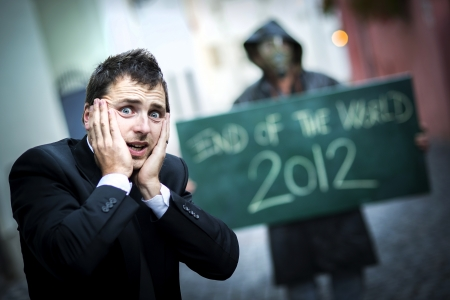 Business man is scared of the end of the world photo