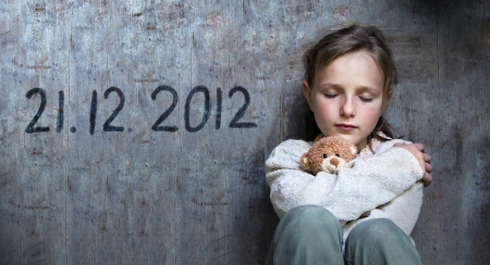 Frightened child with date of end of the world. Stock Photo - 16334598