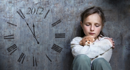 Frightened child with date of end of the world. Stock Photo - 16334596