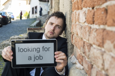 begging: Jobless manager is on the street. Stock Photo