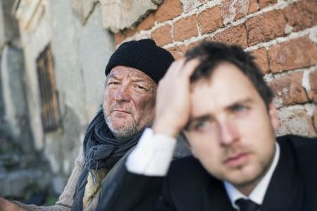 Homeless men are begging on the street. photo