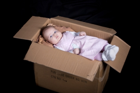 Little baby is posing in box. photo