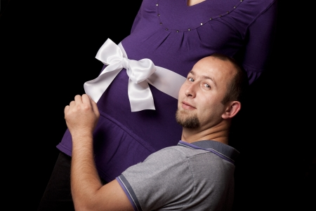 Pregnant couple is awaiting her little baby. photo