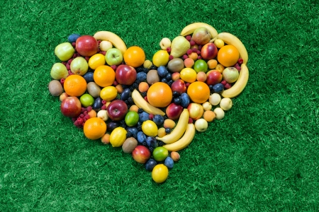 Fruit heart lying on grass photo