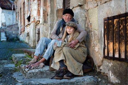 homelessness: Homeless family is begging on the street