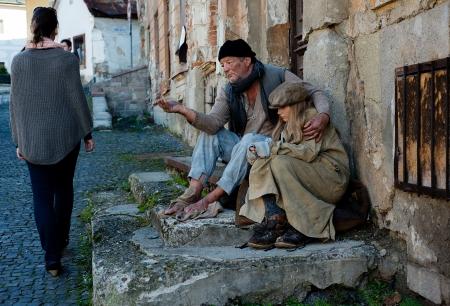 beggars: Beggars are begging for money on the street