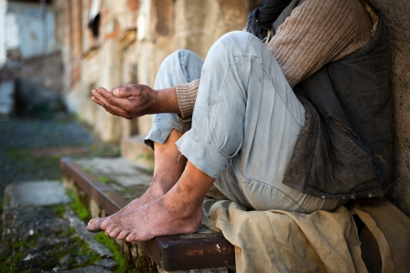 Beggar is begging for food on the street Stock Photo - 16436938